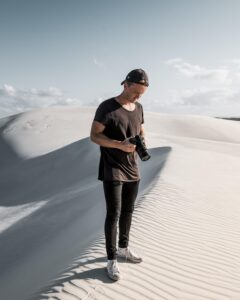 Photographer in Atlantic sand dunes